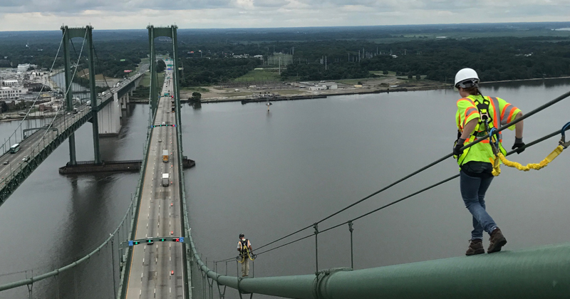 Natalie Teichman on the cables that hold up the Delaware Memorial Bridge